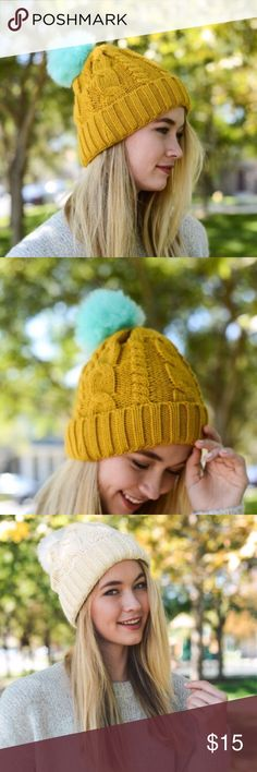 Color Pom cable knit beanie So unique and adorable!!!! Add flair to your fall/winter look. Cozy, soft (not itchy) cable knit. The contrasting pom color is so eye catching! This listing is for mustard with blue pom. I also have the light blue with pinkish pom available. boutique Accessories Hats