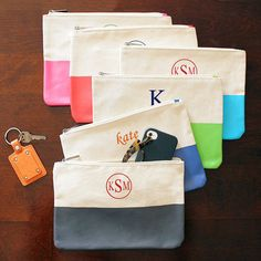 Monogrammed color dipped canvas clutches
