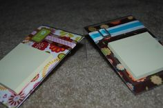 Post it note holder made out of an acrylic frame, scrapbook paper and embellishments