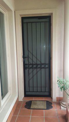 Stunning steel security door with stainless steel mesh installed in Brighton.