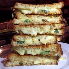 Go wich please at American Whiskey  Instead of the usual Gruyere and Cheddar #AmericanWhiskey uses Fontina for its amazingly gooey Grilled cheese #sandwich stacks. Along with some basil and crushed red peppers their Grilled cheese #sandwiches are just comfort homely food at its best. Cant get enough of cheese? Try their Tater tot poutine  Tater tots topped with chicken gravy and cheddar cheese curds. Guilty pleasure in a bite indeed.  If you enjoyed this post please do  1) Tag your foodie…