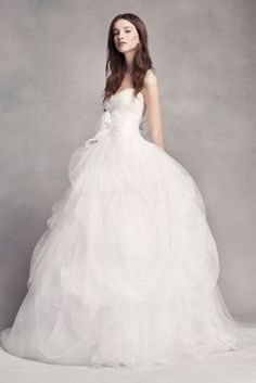 Dramatic yet romantic, this sweetheart ball gown's crisscross bodice is draped by hand, and the skirt's delicate layers of tulle cascade for weightless volume.   White by Vera Wang, exclusively at David's Bridal  Polyester  Chapel train  Back zipper; fully lined  Dry clean  Imported  Sash not included  Paired with veil style VW37V11 Also available in extra length
