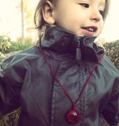 Orion presenting Red Dragon Vein Agate necklace.  #walkinthenature #dragonveinagate #macramejewelry #macramenecklace #micromacramejewelry #micromacramenecklace #crystals #crystalchild #handmadewithlove #handmadejewelry #child #crystalchildren #love #loveandlight #motherhood #mamajewelry #mamacrame