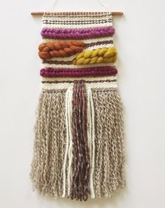 Handwoven one-of-a-kind wall hanging. Created with care and patience on a homemade lap loom. Made with mixed fibers in cotton, wool and hand-dyed