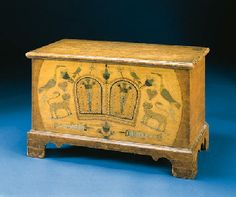 A MUSTARD-PAINTED AND DECORATED BLANKET CHEST CENTRE COUNTY, PENNSYLVANIA, LATE 18TH CENTURY