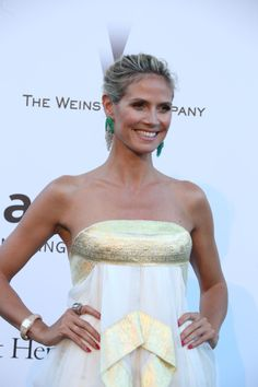 """Heidi Klum paired her Marchesa dress with statement green de GRISOGONO jewels, including earrings from the new 20th anniversary collection, rose gold ring set with brown diamonds and """"Piccolina"""" watch in rose gold set with brown diamonds #Cannes2013"""