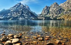"Jenny Lake, Wyoming    Jenny Lake sits right below the peak of Grand Teton and is a landmark for many hiking trails, backcountry trails, and climbing routes. Despite the fact that motorboats are allowed on the lake, its waters are still considered ""pristine."""