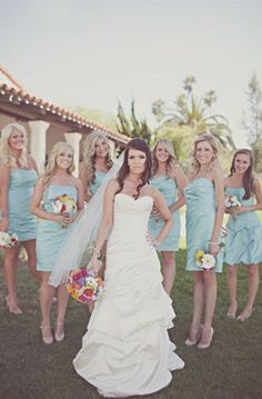 No detail of this colorful California #wedding on @grnweddingshoes went unnoticed, especially not the #bridesmaid dresses! Cerissa outfitted her girls in our sidedraped slim satin dress in playful Pool! David's Bridal Style F44026.