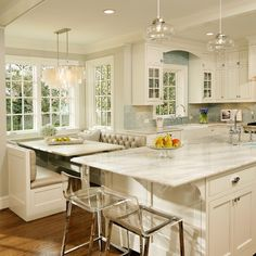 "BM Snowfall White was used on cabinets and trim. Side walls are BM Gray Owl."" ""The cabinets are BM Snowfall White. The pulls are from Top Knobs."" ""Rohl. It is a bridge kitchen faucet with side spray and is a beautiful looking faucet to add to a kitchen."""