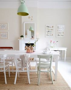 A jute rug brings texture to the pale palette in this Scandi-inspired dining room.   Designer: Yvestown