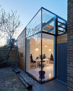 CF Architects have built this timber and glass office on the side of a mid…