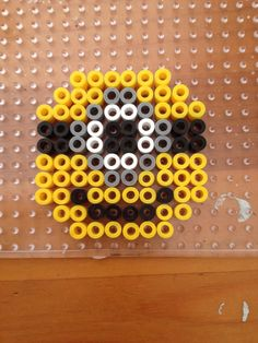 Minion magnet perler beads by Jena-Rose on deviantART. just made this in like 5 min. ITS SO EASY!!!!! :)