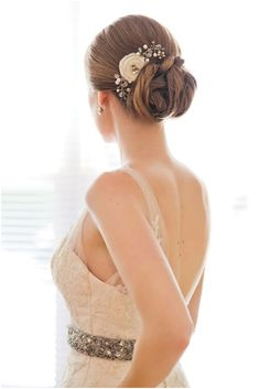 Jewelry adorned Bun:    The hair is pulled behind in a way to form a tight bun with is further adorned with a hair comb on the side