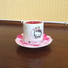 Handmade Candle set in Hello Kitty cup and saucer for sale on EBay.