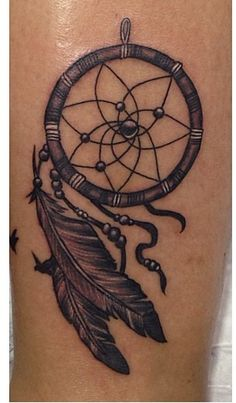 Dreamcatcher tattoo with birds flying out