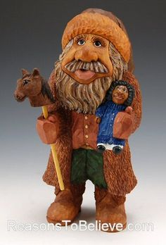 Black Santa with Stick Horse and Doll-Black Santa with Stick Horse and Doll by Debbie Barr. A wonderful African American Santa carving holding both a stick horse as well as a little doll.
