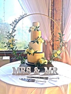 wedding cakes stand This beautiful Champagne and Ivory wedding cake decorated with fresh roses, displayed on a gold hoop cake stand, visit our website to book your dream Sussex wedding cake today, Peacock Wedding Cake, Ivory Wedding Cake, Floral Wedding Cakes, Fall Wedding Cakes, Wedding Cake Designs, Floral Cake, Purple Wedding, Gold Wedding, Wedding Ideas