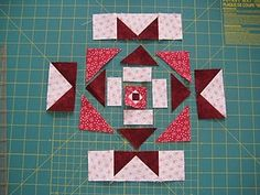 For the most part, this block is pretty simple. It's just an Ohio star with some stuff in the centre.  I started off the the flying geese. ...