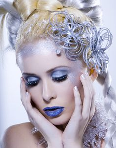Beautiful Frosty look! We have the shimmer cream/powder makeup, blue or silver lipstick, body glitter and white hairspray needed for this look!