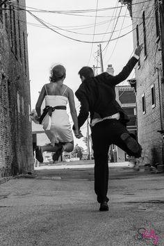 Fun wedding photo of bride and groom celebrating