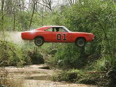 Dukes of Hazzard TV Show 1969 Dodge Charger called the General Lee. Here in my hometown a store has one of the cars like this used as a stunt car. Dodge Charger 1969, Rat Rods, Famous Movie Cars, Film Cars, Dukes Of Hazard, Automobile, Old Classic Cars, Transporter, American Muscle Cars
