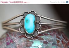Vintage Navajo sterling silver cuff bracelet set with blue turquoise. Cuff is constructed with pulled wire and somewhat misshapen. Measures