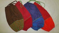 Handmade plastic bag holders made from Shweshwe pure by Toktokkie