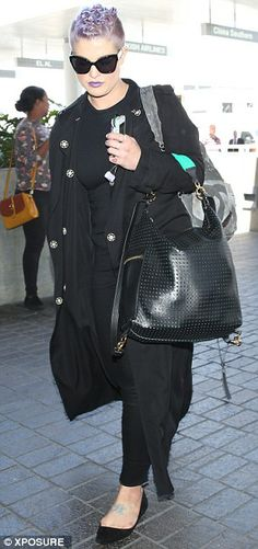 Kelly Osborn rocks. Going to the dark side: The celebrity was dressed in black from head to toe with her lilac...