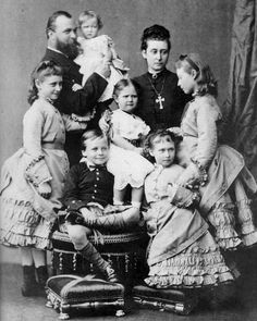 The family of Grand Duke Louis and grand Duchess Alice of Hesse, from left: Princess Victoria, Grand Duke Louis with Princess Marie, Grand Duke Ernst Ludwig on stool, Princess Alix, Grand Duchess Alice, Princess Irene in front, Princess Elisabeth, 1876