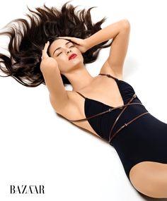 Kendall Jenner wears a black one-piece Michael Kors swimsuit for Harper's Bazaar Magazine June 2016 issue