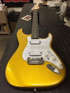 Here's a Legacy HB2 in Yukon Gold Metallic, 3-ply white guard, white pickups and knobs, rosewood board, Clear Satin neck finish. G & L