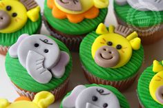 Elephant, giraffe and lion cupcakes for a birthday party.