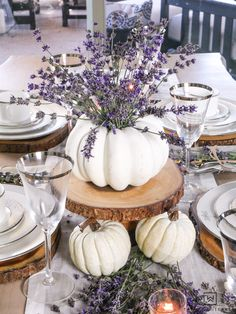 Create a simple and beautiful pumpkin centerpiece using white pumpkins and sprigs of lavender! #lavender #falltable #lavendertable