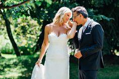 groom kissing bride on her hand