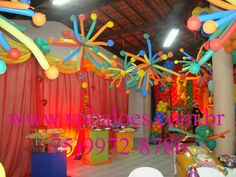 It looks like this was achieved with balloons but I think something similar could be achieved with pool noodles that would last longer.