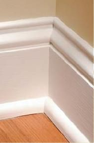 DIY tall baseboards - MDF strips for the flat part, then small molding on top. The premade tall molding is expensive in stores, so do it this way!