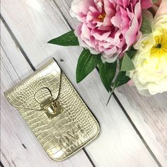 Mini satchel/phone purse Gold snakeskin design. Condition is like new. Received as a gift from friend and never used it. Comes with strap. Have not measured strap as it is still packaged. But can provide if needed! Make me an offer! Bags Mini Bags