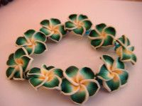 """floral stretch bangle beautiful green/yellow flowers green beads 6""""long nice ite"""