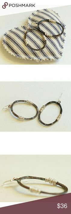 """LA Indy Designer Eco Hammered Hoops/Silver Wire These are lead-and nickle-free, hammered and patina'd brass/copper blend hoops with silver wire wrap design. There are hints of cyan to the patina. Very delicate, these dangle about 1& 5/8th"""" long, with the inner circle measuring an inch across. So minimalist, classic and elegant. New, never worn. Enjoy! Designer Jewelry Earrings"""