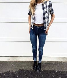 White top with checkered and blue denim jeans |