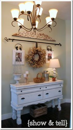 Maybe move coat hooks behind the door and then have a narrow unit like this...boot tray underneath but drawers/cupboards for keys, gloves etc.