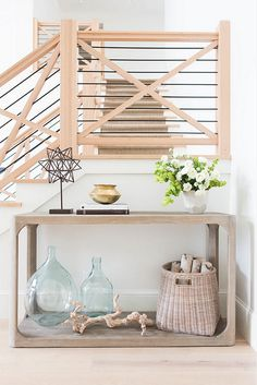 Love the natural elements of the  decor and stair banister.