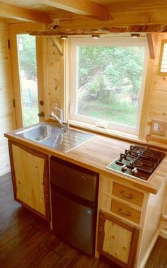 The client wanted as much natural live edged wood exposed as possible, so the Oregon Cottage Company included the edges on the shelf above the kitchen sink and cabinet door rails.
