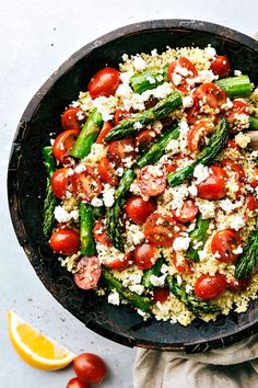 Roasted asparagus, tomato, couscous, and feta cheese with a simple vinaigrette. A great Spring or Easter side dish! via chelseasmessyapron.com