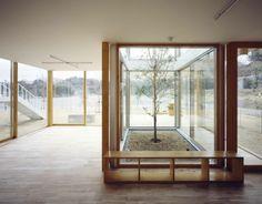Hongodai Christ Church School & Nursery designed by Takeshi Hosaka Architects. Internal gardens and floor to ceiling sliding glass doors.