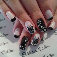 Black and white themed butterfly nail art design. Stunning and quirky looking. Truly a butterfly nail art design that stands out and makes a statement because of how artistic the butterfly outlines curves are painted in contrasting colors.