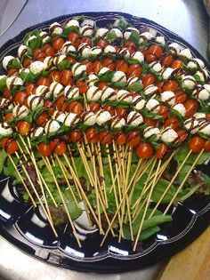 Tomato Mozzarella Basil Skewers with Balsamic Drizzle... Seriously the best healthy party tray food I have ever eaten