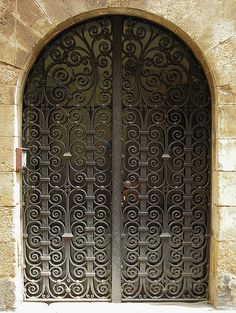Door with ironwork, la Bisbal d'Emporda, Catalunya, Spain by cocoi_m, via Flickr