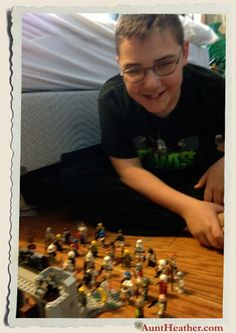Kyle lining up his Lego figures for battle. 2013 #AuntHeather