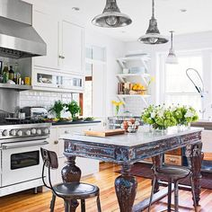 A furniture-style table with a granite top is an eye-catching focal point in this kitchen. More kitchen island designs: . New Kitchen, Kitchen Dining, Kitchen Decor, Stylish Kitchen, Rustic Kitchen, Country Kitchen, Kitchen Ideas, Cottage Kitchens, Home Kitchens